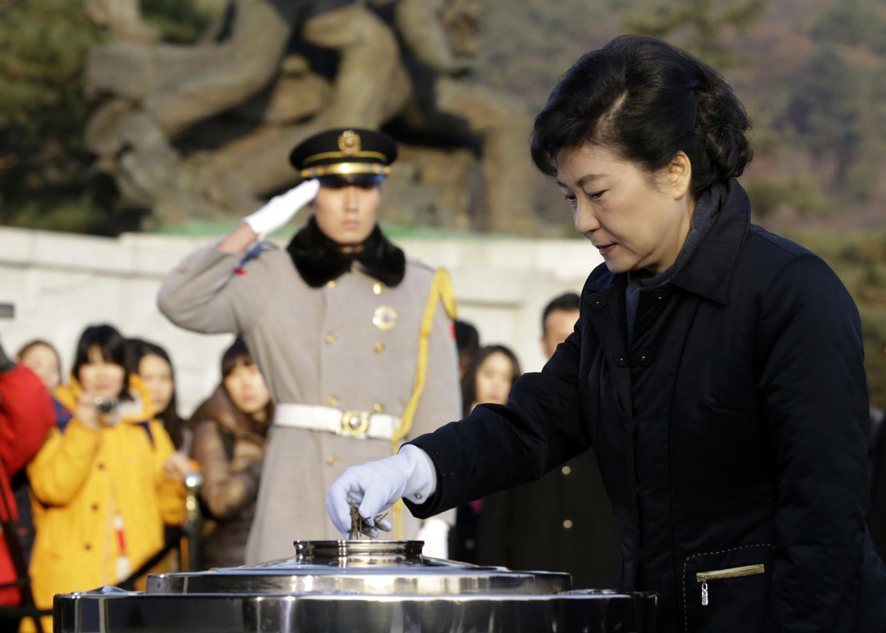 South Korean President-elect Park Geun-hye of the ruling Saenuri Party burns incense during her visit to the National Cemetery in Seoul, South Korea, Thursday, Dec. 20, 2012. Park, daughter of a divisive military strongman from South Korea's authoritarian era, was elected the country's first female president Wednesday, a landmark win that could mean a new drive to start talks with rival North Korea. (AP Photo/Lee Jin-man, Pool)