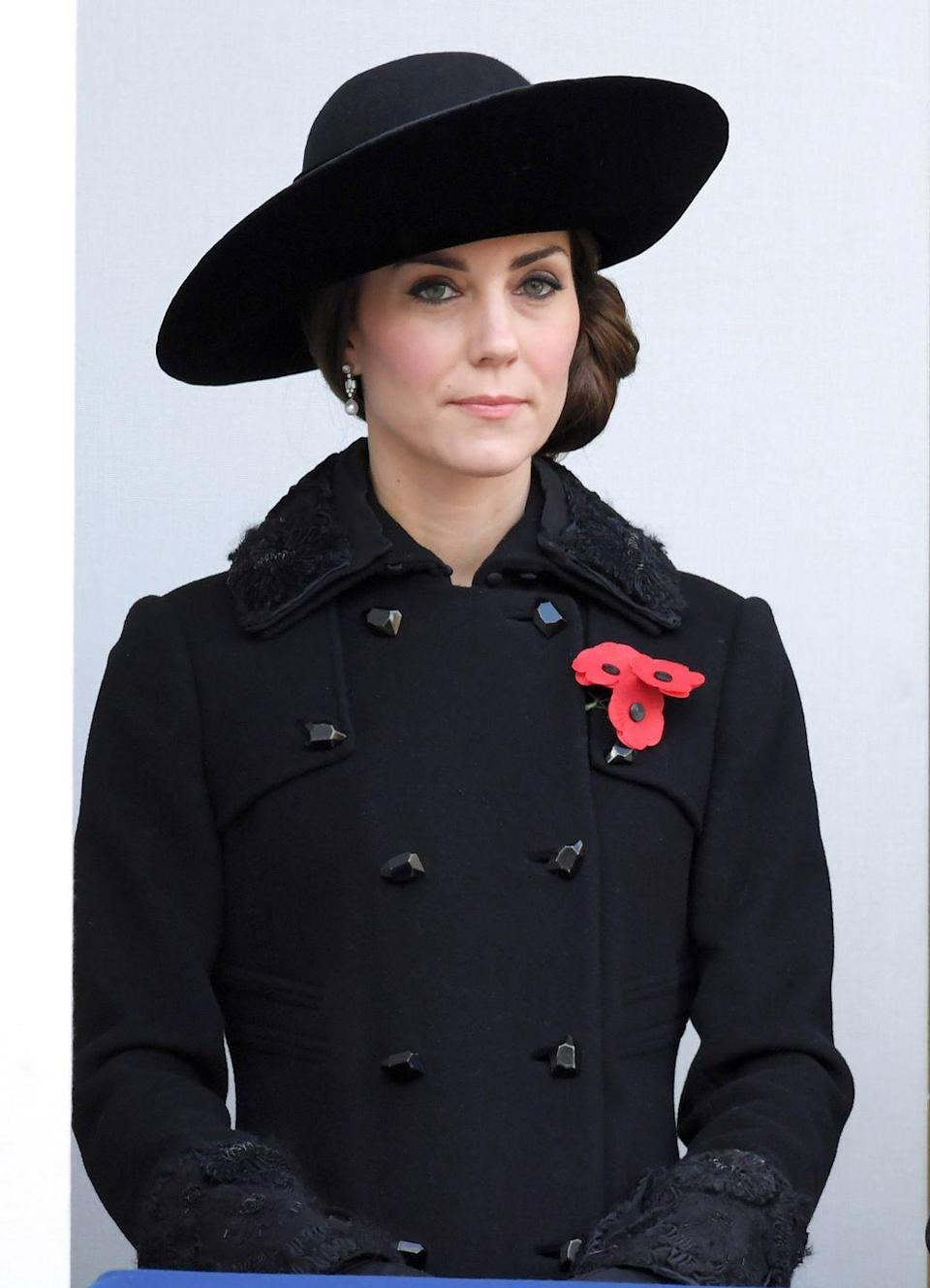 <p>In England, the poppy is a sign of remembrance, and it's used to honor military personnel who have died in war. Kate wore it with an all-black outfit to a Remembrance Sunday Service in 2016. </p>