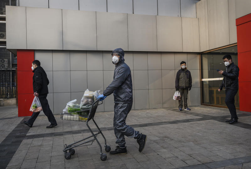 BEIJING, CHINA - FEBRUARY 11: A Chinese worker wears a protective suit and mask as he helps a customer to his car with his groceries at a supermarket on February 11, 2020 in Beijing, China. The number of cases of a deadly new coronavirus rose to more than 42000 in mainland China Tuesday, days after the World Health Organization (WHO) declared the outbreak a global public health emergency. China continued to lock down the city of Wuhan in an effort to contain the spread of the pneumonia-like disease which medicals experts have confirmed can be passed from human to human. In an unprecedented move, Chinese authorities have put travel restrictions on the city which is the epicentre of the virus and municipalities in other parts of the country affecting tens of millions of people. The number of those who have died from the virus in China climbed to over 1000 on Tuesday, mostly in Hubei province, and cases have been reported in other countries including the United States, Canada, Australia, Japan, South Korea, India, the United Kingdom, Germany, France and several others. The World Health Organization has warned all governments to be on alert and screening has been stepped up at airports around the world. Some countries, including the United States, have put restrictions on Chinese travellers entering and advised their citizens against travel to China. (Photo by Kevin Frayer/Getty Images)