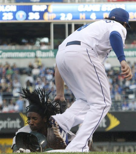 Oakland Athletics' Jemile Weeks is tagged out by Kansas City Royals third baseman Mike Moustakas during the third inning of a baseball game in Kansas City, Mo., Friday, June 1, 2012. (AP Photo/Orlin Wagner)
