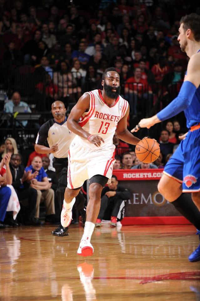 HOUSTON, TX - JANUARY 3: James Harden #13 of the Houston Rockets drives against the New York Knicks on January 3, 2014 at the Toyota Center in Houston, Texas. (Photo by Bill Baptist/NBAE via Getty Images)