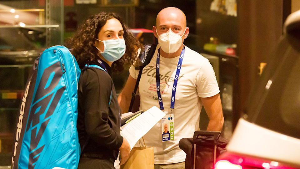 Martina Trevisan and coach Matteo Cartarsi, pictured here leaving the Hyatt Hotel in Melbourne.