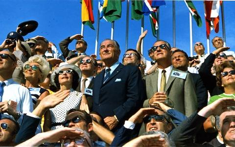 Former president Lyndon Johnson and Vice President Spiro Agnew watch as Apollo 11 is blasted into the sky - Credit: NASA
