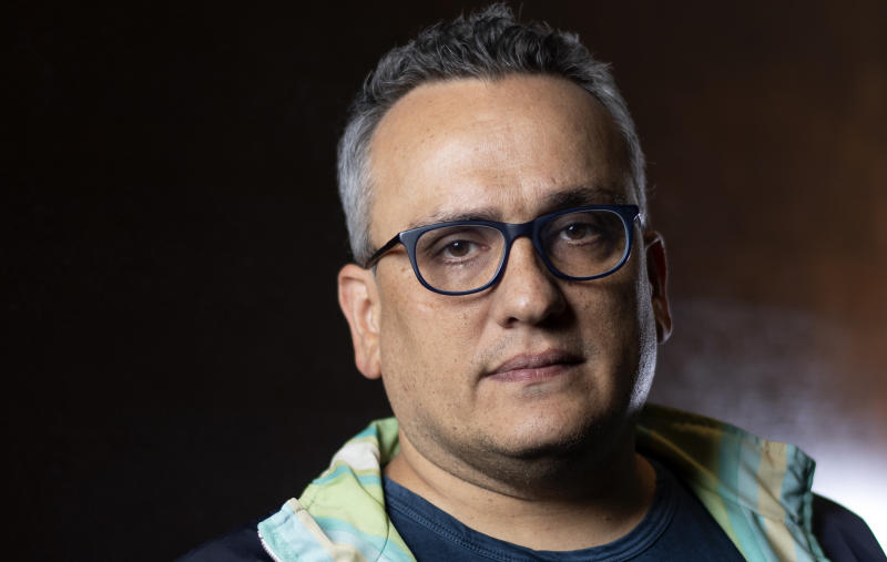 "Director Joseph Russo poses during a photo session for AFP at the 2019 Toronto International Film Festival Day 5 on September 9, 2019, in Toronto, Ontario. - When you have just directed the biggest blockbuster movie of all time, you earn the clout to dictate terms with even the highest executives in Hollywood. But for the Russo brothers, it also raised a question that would be familiar to the superheroes of ""Avengers: Endgame"" -- what to do next with all that power? (Photo by VALERIE MACON / AFP) (Photo credit should read VALERIE MACON/AFP via Getty Images)"