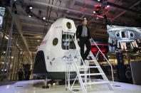 FILE - In this Thursday, May 29, 2014 file photo, Elon Musk, CEO and CTO of SpaceX, walks down the steps during the introduction of the SpaceX Dragon V2 spaceship at the headquarters in Hawthorne, Calif., designed to ferry astronauts to low-Earth orbit. (AP Photo/Jae C. Hong)