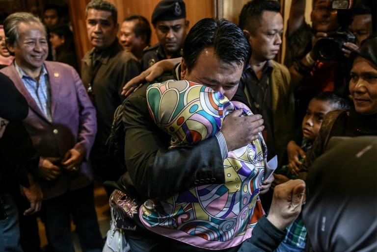 Malaysians freed by Pyongyang made an emotional return Friday after landing at Kuala Lumpur international airport