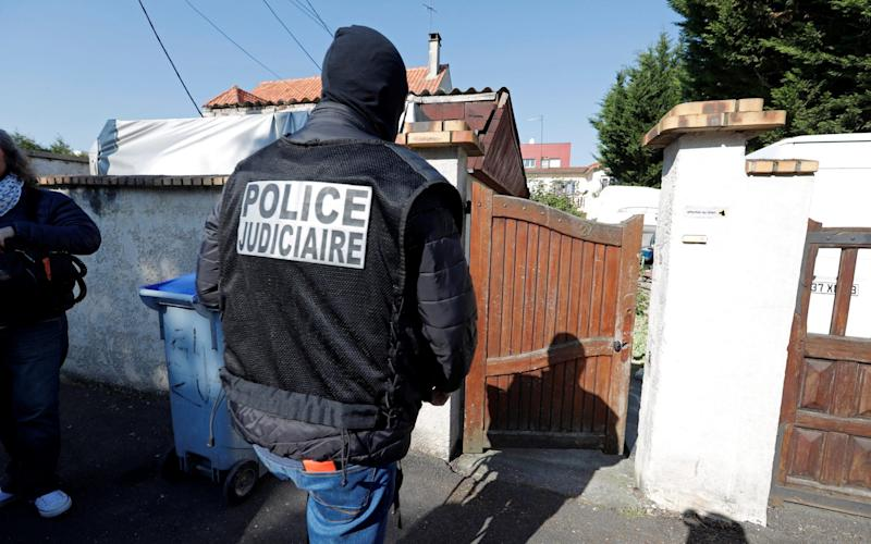 French police arrive at the house of the gunman killed in a shootout with police on the Champs Elysees Avenue, in the Paris suburb of Chelles - Credit: REUTERS/Charles Platiau