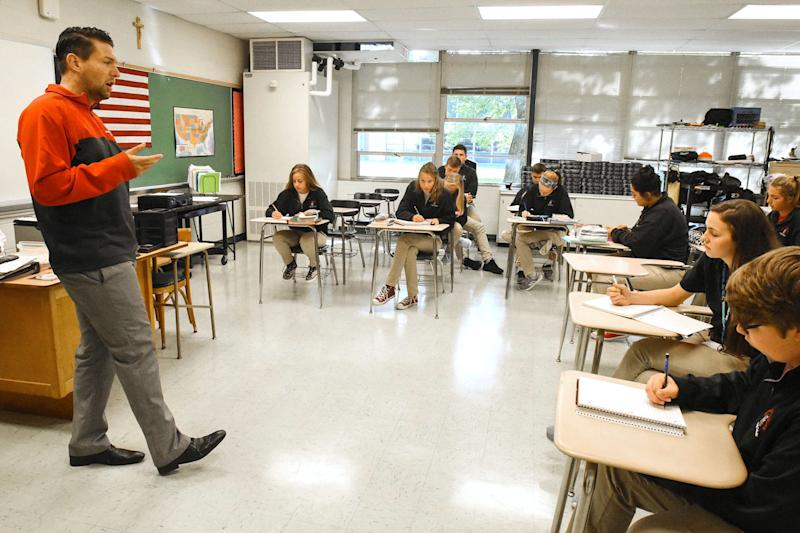 Jordan Miller teaches a junior English class at Bishop Luers High School in Fort Wayne.