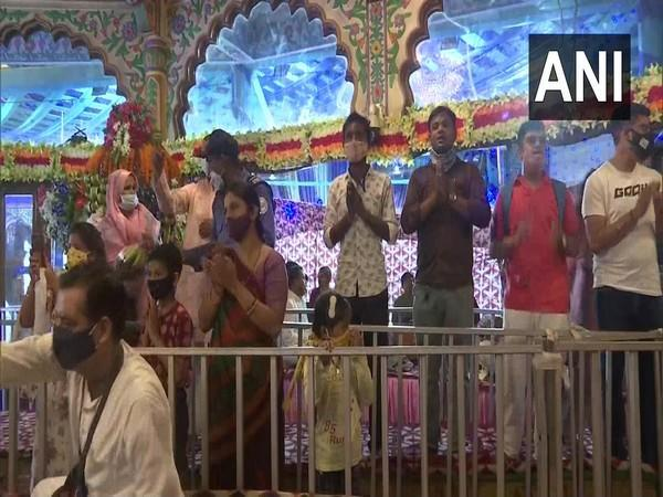 Visuals of the devotees offering prayers at the ISKCON temple, Punjabi Bagh. (Photo/ANI)