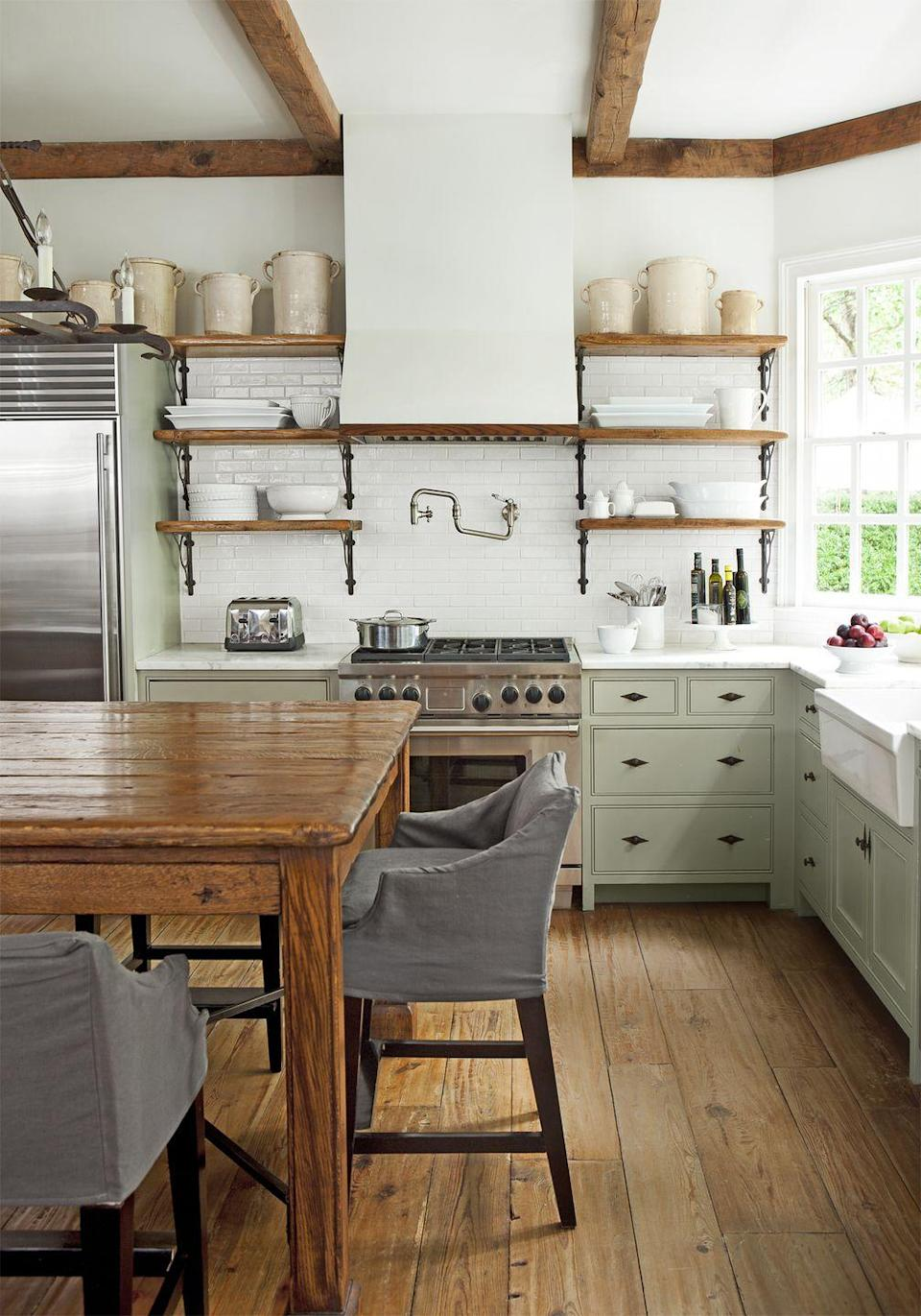 "<p>The kitchen is the most utilitarian room in the house, which is why you obsess over the appliances, the backsplash, the sink...But it's also the heart of the home. Subtle touches such as slipcovers, decorative hardware, and prized collections serve up a little softness. </p><p><strong>Bonus idea: </strong>Save the top shelf for precious collectibles, and leave the lower ones to everyday items.</p><p><a class=""link rapid-noclick-resp"" href=""https://go.redirectingat.com?id=74968X1596630&url=https%3A%2F%2Fwww.homedepot.com%2Fs%2Fslipcovers&sref=https%3A%2F%2Fwww.countryliving.com%2Fhome-design%2Fdecorating-ideas%2Fg3988%2Fkitchen-trends%2F"" rel=""nofollow noopener"" target=""_blank"" data-ylk=""slk:SHOP SLIPCOVERS"">SHOP SLIPCOVERS</a></p>"