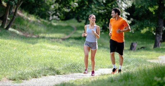 Couple jogging outside on a sunny day | nd3000/Getty Images