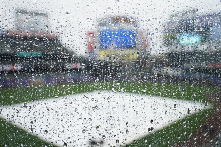 Raindrops cover a plastic barrier on the upper deck at Citi Field as a baseball game between the New York Mets and the Atlanta Braves is postponed due to rain, Sunday, May 30, 2021, in New York. (AP Photo/Kathy Willens)
