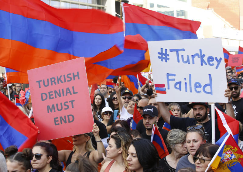 Huge crowds of Armenian Americans march during an annual commemoration of the deaths of 1.5 million Armenians under the Ottoman Empire in Los Angeles Wednesday, April 24, 2019. The march was intended to press demands that Turkey, the successor of the Ottoman Empire, recognize the deaths as genocide. Turkey contends the deaths starting in 1915 were due to civil war and unrest. (AP Photo/Damian Dovarganes)