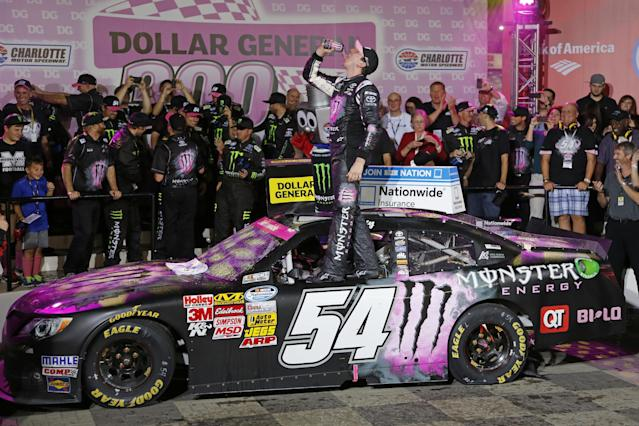 Kyle Busch celebrates in Victory Lane after winning the NASCAR Nationwide series auto race at Charlotte Motor Speedway in Concord, N.C., Friday, Oct. 11, 2013. (AP Photo/Terry Renna)