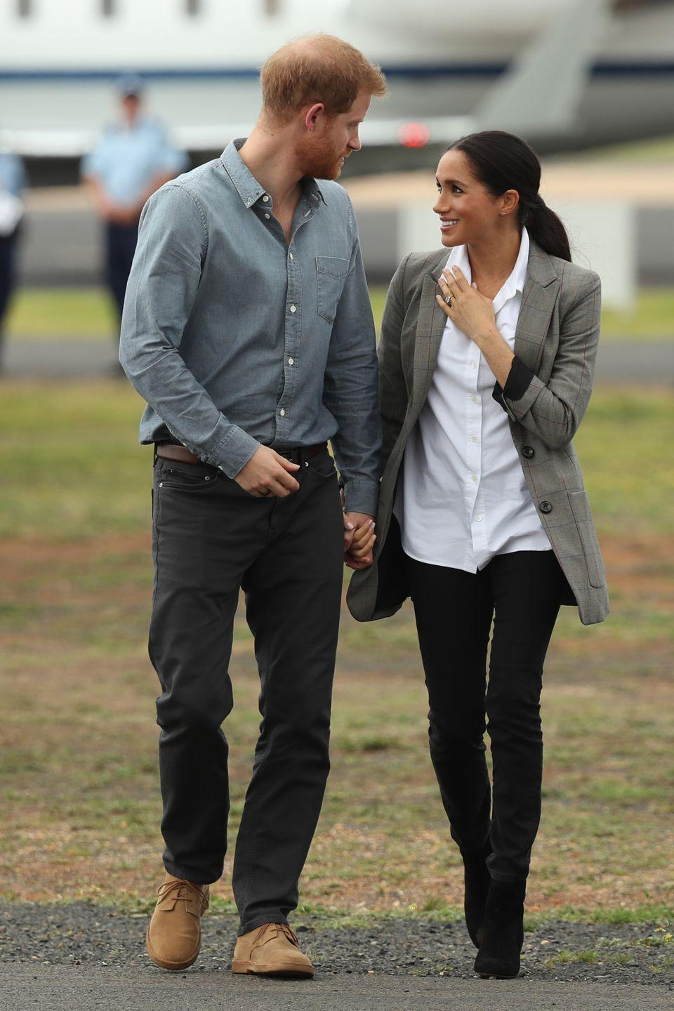 <p>The Duchess of Sussex added a gray-checked oversized blazer to her black and white ensemble visiting Australia in October 2018.</p>