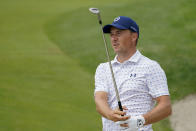 Jordan Spieth watches his shot from a sand trap onto the sixth green in the third round at the Northern Trust golf tournament, Saturday, Aug. 21, 2021, at Liberty National Golf Course in Jersey City, N.J. (AP Photo/John Minchillo)