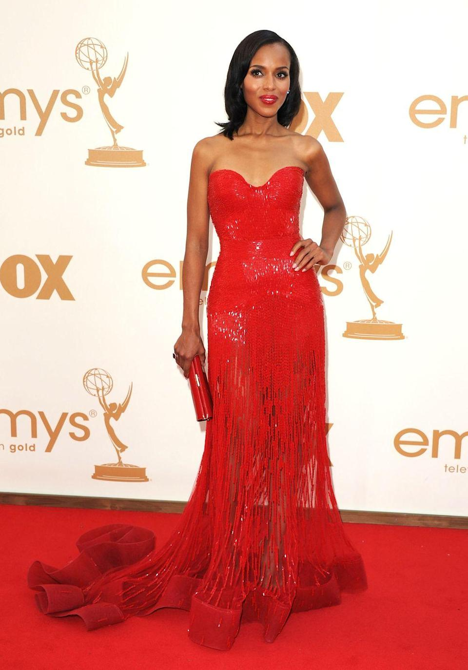 <p>Washington wowed in this red dress at the 2011 Emmy Awards. </p>