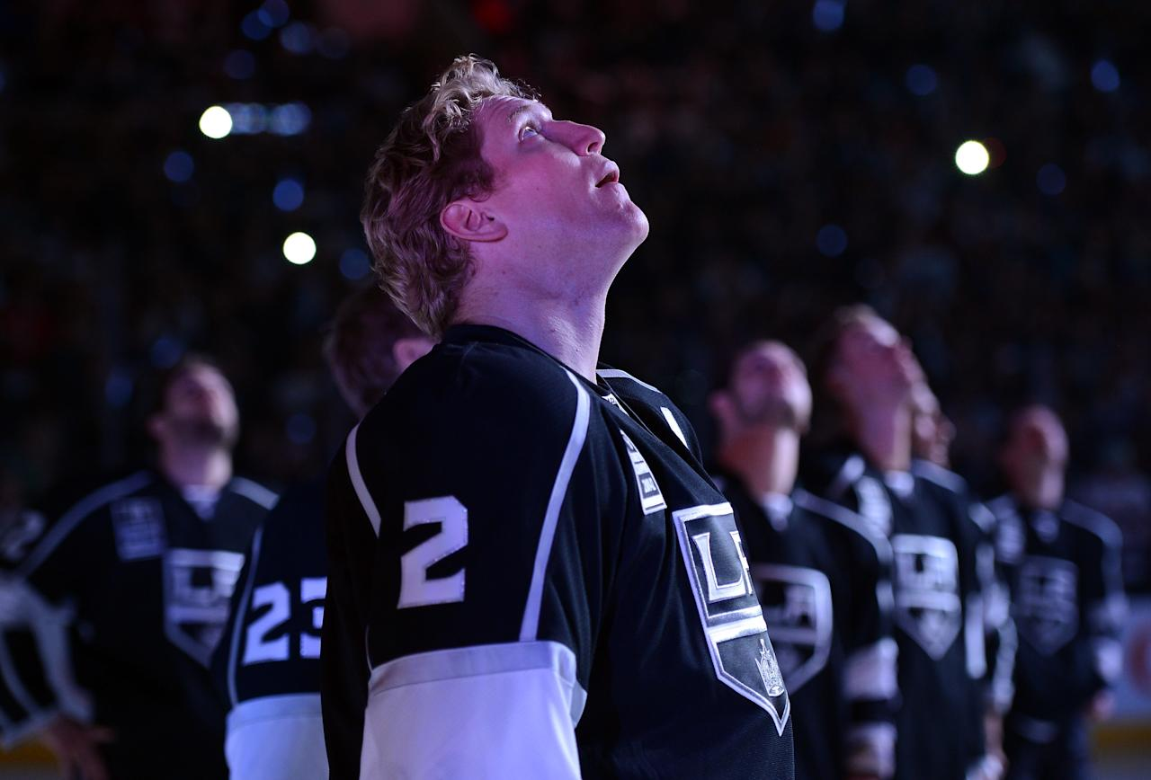 LOS ANGELES, CA - JANUARY 19:  Matt Greene #2 of the Los Angeles Kings watches as the 2001-12 Stanley Cup banner is raised during a ceremony before the NHL season opening game against the Chicago Blackhawks at Staples Center on January 19, 2013 in Los Angeles, California.  (Photo by Harry How/Getty Images)