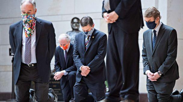 PHOTO: Senators kneel during a moment of silence with Senate Democrats to protest the deaths of George Floyd, Ahmaud Arbery, Breonna Taylor and other victims of racial injustice in the Capitol's Emancipation Hall, June 4, 2020. (Tom Williams/CQ Roll Call/Newscom)