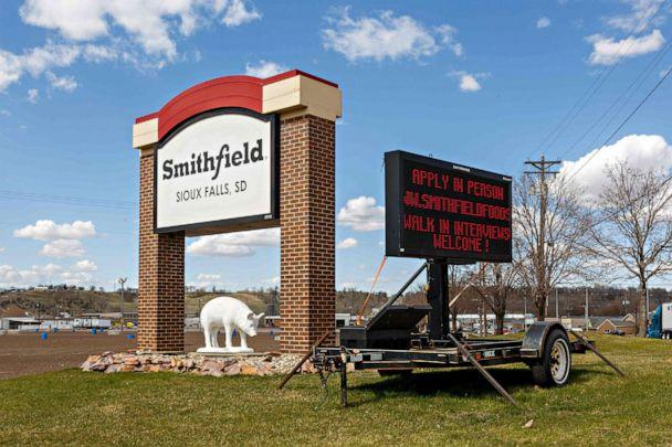 PHOTO: A sign outside the Smithfield Foods pork processing plant in South Dakota, one of the country's largest known coronavirus clusters, is seen, on April 21, 2020, in Sioux Falls, South Dakota. (Kerem Yucel/AFP/Getty Images)