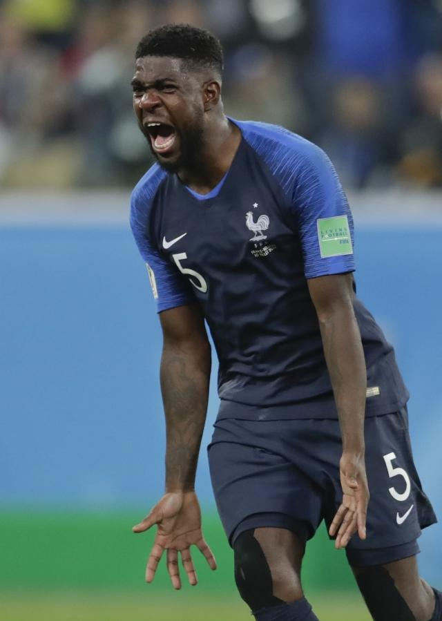 <p>France's Samuel Umtiti celebrates at the end of the semifinal match between France and Belgium at the 2018 soccer World Cup in the St. Petersburg Stadium, in St. Petersburg, Russia, Tuesday, July 10, 2018. France won 1-0. (AP Photo/Petr David Josek) </p>