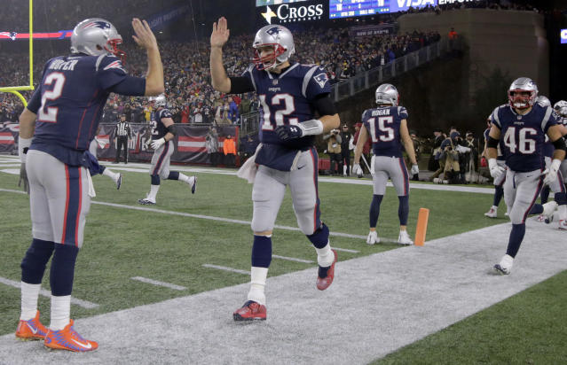 New England Patriots quarterback Tom Brady, (12) is congratulated by Brian Hoyer, left, after his touchdown pass to Josh Gordon during the second half of an NFL football game against the Minnesota Vikings, Sunday, Dec. 2, 2018, in Foxborough, Mass. It was Brady's 579th career touchdown pass, which tied him for the most passing touchdowns in NFL history. (AP Photo/Steven Senne)