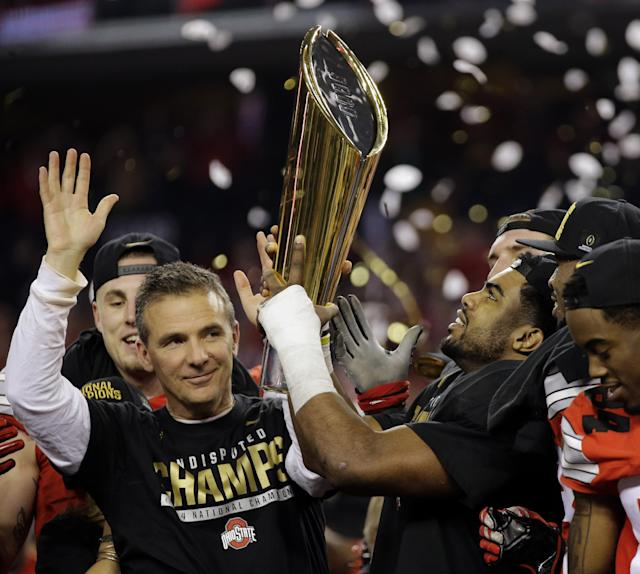 Urban Meyer and Ezekiel Elliott celebrate after Ohio State's College Football Playoff title win. (AP)