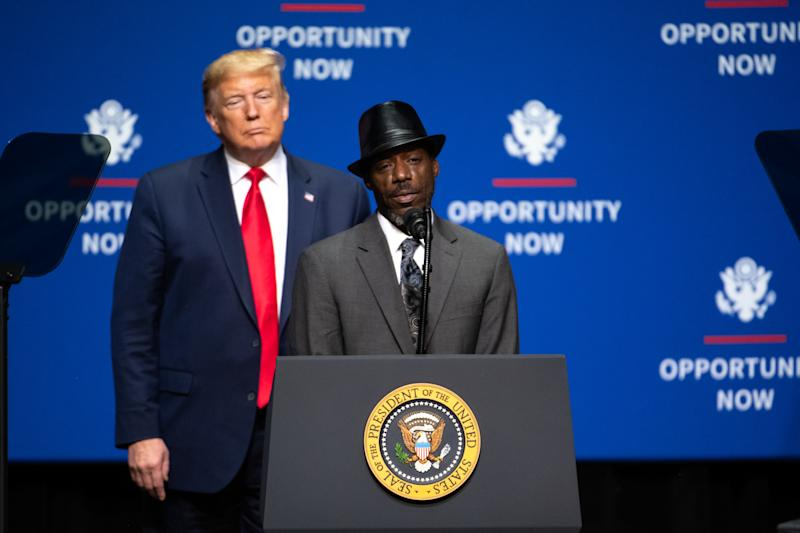 Tony Rankins addresses the crowd during the Opportunity Now summit as US President Donald Trump looks on, at Central Piedmont Community College in Charlotte, North Carolina.