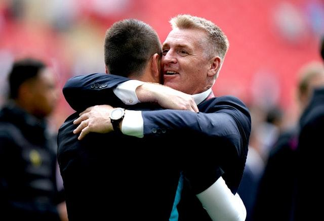 Dean Smith hugs assistant coach John Terry after Villa's play-off final triumph against Derby (John Walton/PA)