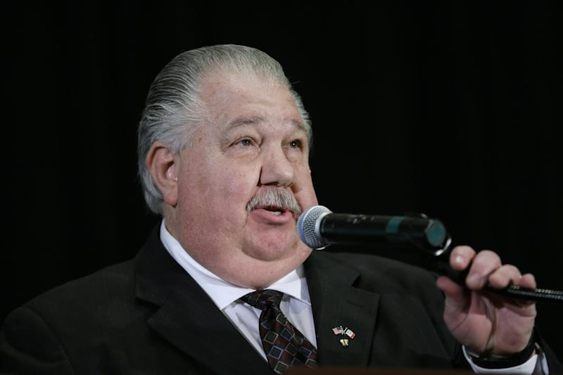 """FILE-- In this April 11, 2014, file photo, Iowa Senate candidate Sam Clovis speaks during the Iowa Republican Party's annual Lincoln Day dinner in Cedar Rapids, Iowa. A GOP TV spot comparing castrating hogs to cutting spending, and Democrat Bruce Braley's comment that lawyers like him are better suited to serve on the Senate Judiciary Committee than """"an Iowa farmer"""" like U.S. Sen. Charles Grassley, have raised the Iowa's open Senate seat on the GOP's list of winnable races in the 2014 elections. (AP Photo/Charlie Neibergall)"""
