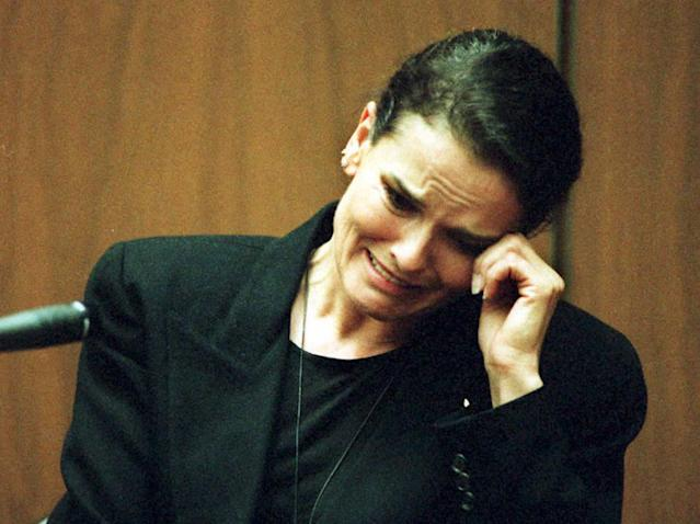 <p>Denise Brown, sister of murder victim Nicole Brown-Simpson, cries as she testifies on the witness stand during the O.J. Simpson murder trial Feb. 3 in Los Angeles, Calif. Brown had recalled an incident she witnessed when O.J. Simpson became angry at his ex-wife, throwing her to the ground outside their home. (Photo: Pool/AFP/Getty Images) </p>