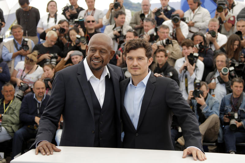 Actors Forest Whitaker, left, and Orlando Bloom pose for photographers during a photo call for the film Zulu at the 66th international film festival, in Cannes, southern France, Sunday, May 26, 2013. (AP Photo/Francois Mori)