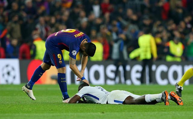 Soccer Football - Champions League Round of 16 Second Leg - FC Barcelona vs Chelsea - Camp Nou, Barcelona, Spain - March 14, 2018 Barcelona's Luis Suarez consoles Chelsea's Antonio Rudiger after the match REUTERS/Albert Gea