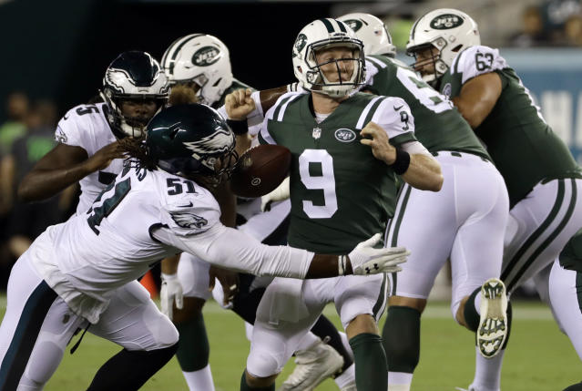 Philadelphia Eagles' Steven Means (51) knocks the ball loose from New York Jets' John Wolford (9) during the second half of a preseason NFL football game Thursday, Aug. 30, 2018, in Philadelphia. (AP Photo/Michael Perez)