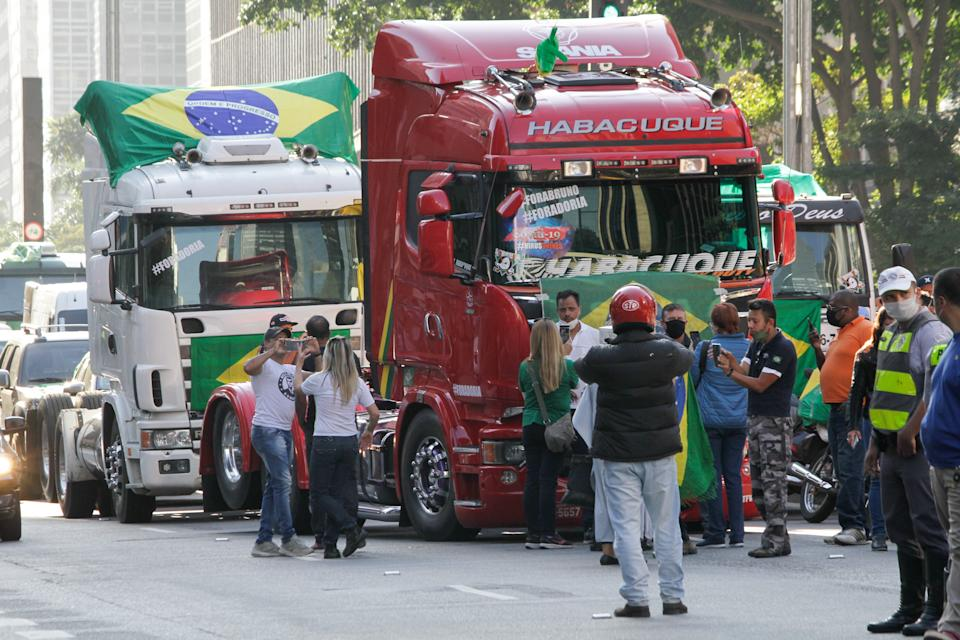 Truck drivers take part in a demonstration in Sao Paulo, Brazil, on May 11, 2020 to protest against the expanded rotation for vehicles in the capital and against the extension of the quarantine in the state of Sao Paulo. (Photo by Fabio Vieira/FotoRua/NurPhoto via Getty Images)