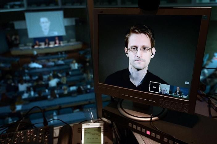 Edward Snowden will tried for espionage and other charges carrying up to 30 years in prison, should he ever return to the United States (AFP Photo/Frederick Florin)