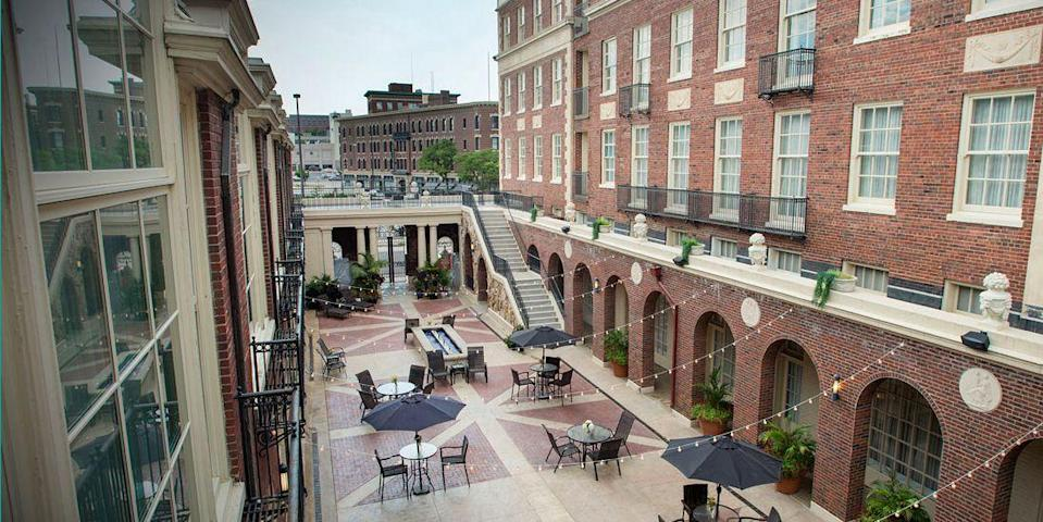 """<p>In downtown Omaha near the Old Market, <a href=""""https://go.redirectingat.com?id=74968X1596630&url=https%3A%2F%2Fwww.tripadvisor.com%2FHotel_Review-g60885-d91528-Reviews-Magnolia_Hotel_Omaha-Omaha_Nebraska.html&sref=https%3A%2F%2Fwww.redbookmag.com%2Fabout%2Fg34149750%2Fmost-historic-hotels%2F"""" rel=""""nofollow noopener"""" target=""""_blank"""" data-ylk=""""slk:Magnolia Omaha Hotel"""" class=""""link rapid-noclick-resp"""">Magnolia Omaha Hotel</a> was built in 1923 in the style of an Italian palazzo. Though it's been throughly updated with modern amenities, you'll still find original marble flooring, travertine walls, and Roman-style columns. </p>"""