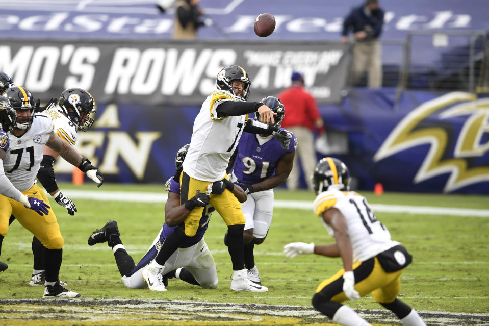 Pittsburgh Steelers quarterback Ben Roethlisberger (7) attempts a pass as Baltimore Ravens linebacker Jaylon Ferguson tries to sack him during the second half of an NFL football game, Sunday, Nov. 1, 2020, in Baltimore. (AP Photo/Nick Wass)