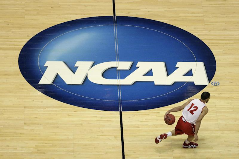 Wisconsin's Traevon Jackson dribbles past the NCAA logo during practice at the NCAA men's college basketball tournament Wednesday, March 26, 2014, in Anaheim, Calif. Wisconsin plays  Baylor in a regional semifinal on Thursday