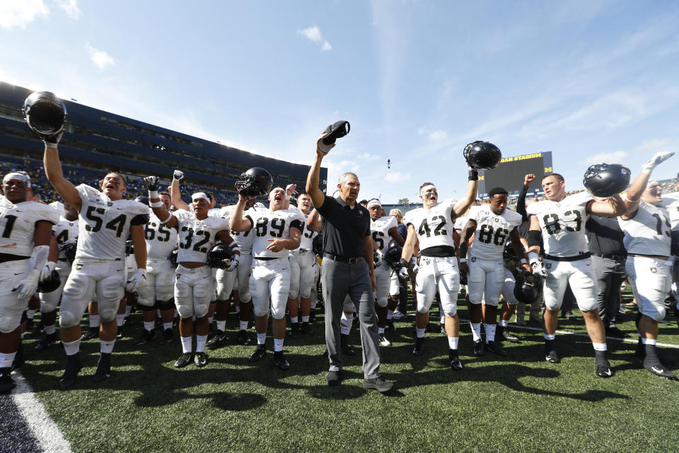 Army head coach Jeff Monken stands with his team singing after an NCAA college football game against Michigan in Ann Arbor, Mich., Saturday, Sept. 7, 2019. Michigan won 24-21 in double-overtime. (AP Photo/Paul Sancya)