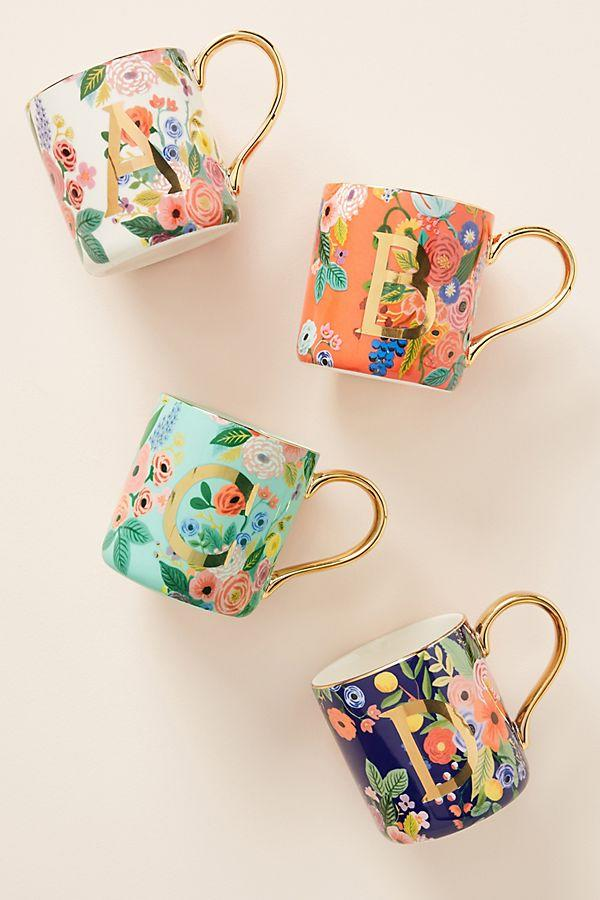 """<h3><a href=""""https://www.anthropologie.com/shop/rifle-paper-co-for-anthropologie-garden-party-monogram-mug"""" rel=""""nofollow noopener"""" target=""""_blank"""" data-ylk=""""slk:Anthropologie Rifle Paper Co. Garden Party Mug"""" class=""""link rapid-noclick-resp"""">Anthropologie Rifle Paper Co. Garden Party Mug</a></h3><br>R29 readers love a good home collab — and <a href=""""https://www.refinery29.com/en-us/2019/11/8702606/anthropologie-rifle-paper-holiday-collection-2019"""" rel=""""nofollow noopener"""" target=""""_blank"""" data-ylk=""""slk:Anthropologie's annual holiday launch with Rifle Paper Co."""" class=""""link rapid-noclick-resp"""">Anthropologie's annual holiday launch with Rifle Paper Co.</a> did not disappoint. The entire <a href=""""https://www.anthropologie.com/brands/rifle-paper-co"""" rel=""""nofollow noopener"""" target=""""_blank"""" data-ylk=""""slk:whimsical collection"""" class=""""link rapid-noclick-resp"""">whimsical collection</a> of gilded kitchenware and bedding is now 30% off. <br><br><strong>Rifle Paper Co. Anthropologie</strong> Garden Party Monogram Mug, $, available at <a href=""""https://www.anthropologie.com/shop/rifle-paper-co-for-anthropologie-garden-party-monogram-mug?category=all-home-gifts&color=901&type=STANDARD"""" rel=""""nofollow noopener"""" target=""""_blank"""" data-ylk=""""slk:Anthropologie"""" class=""""link rapid-noclick-resp"""">Anthropologie</a>"""