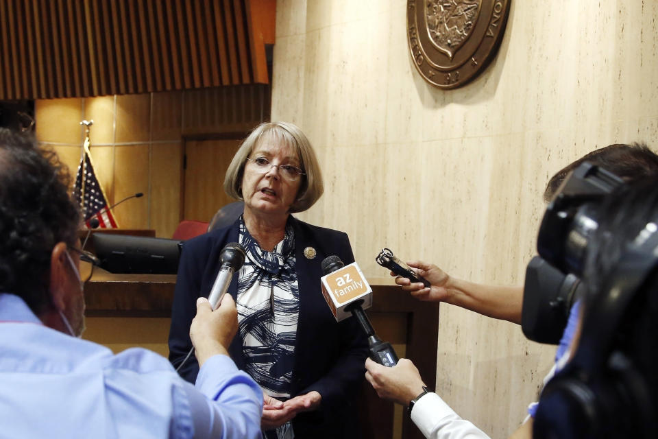 FILE - In this May 26, 2020, file photo, Arizona Senate President Karen Fann, R-Prescott, speaks to the media in Phoenix. Fann said the delivery of a report on the 2020 vote count to Arizona state Senate Republicans was delayed, Monday, Aug. 23, 2021, after the Donald Trump supporter hired to lead the effort and several others involved contracted COVID-19. Fann said she still expects to receive a portion of the report, Monday, but did not give a date for delivery of the full draft. (AP Photo/Ross D. Franklin, File)