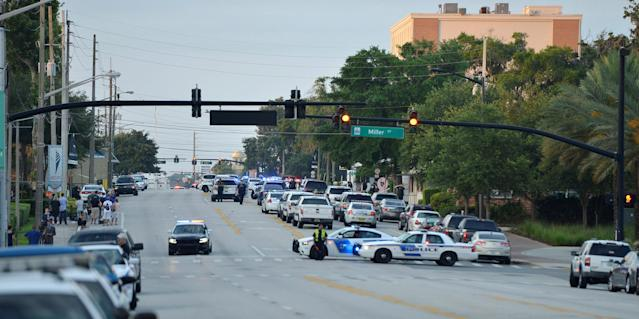 <p>Police lock down Orange Avenue around Pulse nightclub, where people were killed by a gunman in a shooting rampage in Orlando, Florida June 12, 2016. (REUTERS/Kevin Kolczynski) </p>