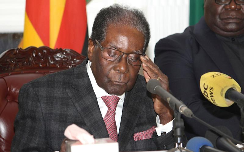 With the camera still rolling, Robert Mugabe apologised for missing several pages from his speech - AP