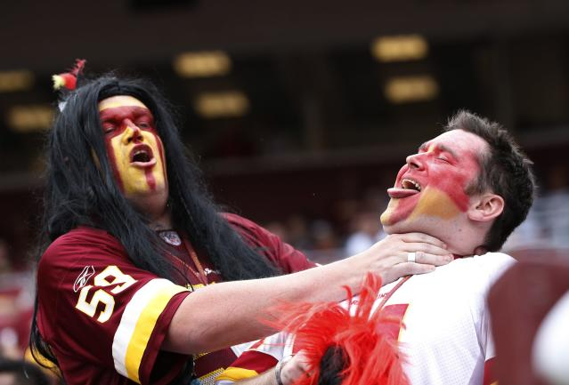 Washington Redskins fans react to their team losing their NFL football game against the Detroit Lions in Landover September 22, 2013. REUTERS/Jason Reed (UNITED STATES - Tags: SPORT FOOTBALL)