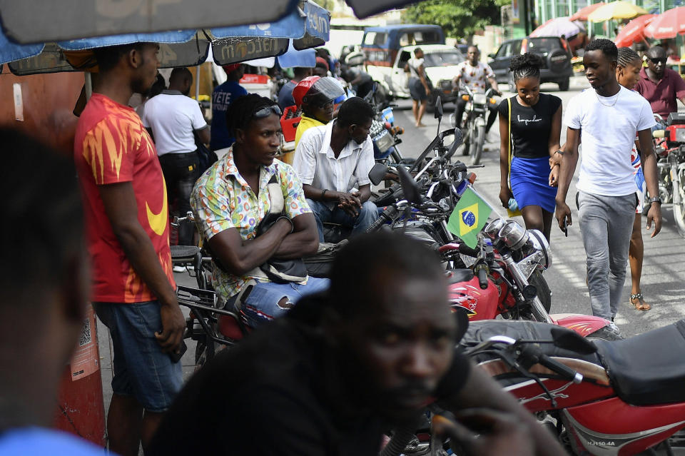 Mototaxi drivers wait for customers in Port-au-Prince, Haiti, Saturday, July 10, 2021, three days after President Jovenel Moise was assassinated in his home. (AP Photo/Matias Delacroix)