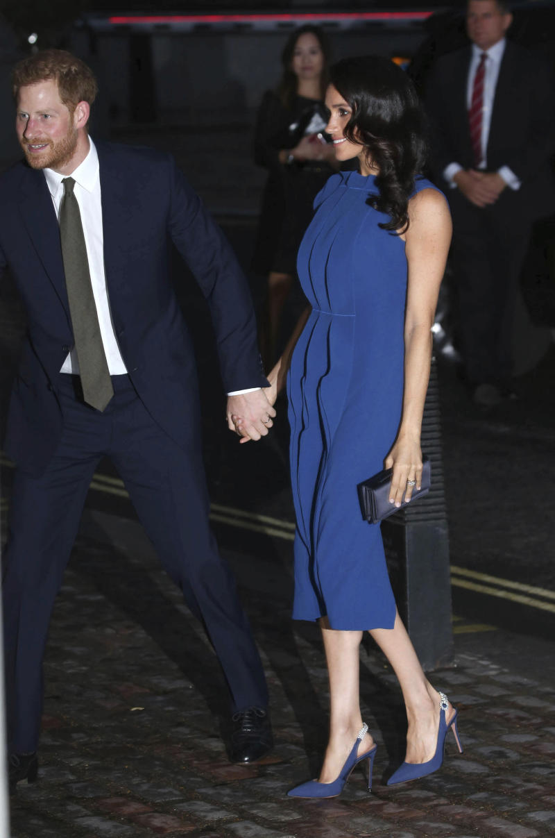 Meghan and Harry at the 100 Days to Peace Gala in London. Was this dress a calculated choice to camouflage her pregnancy?