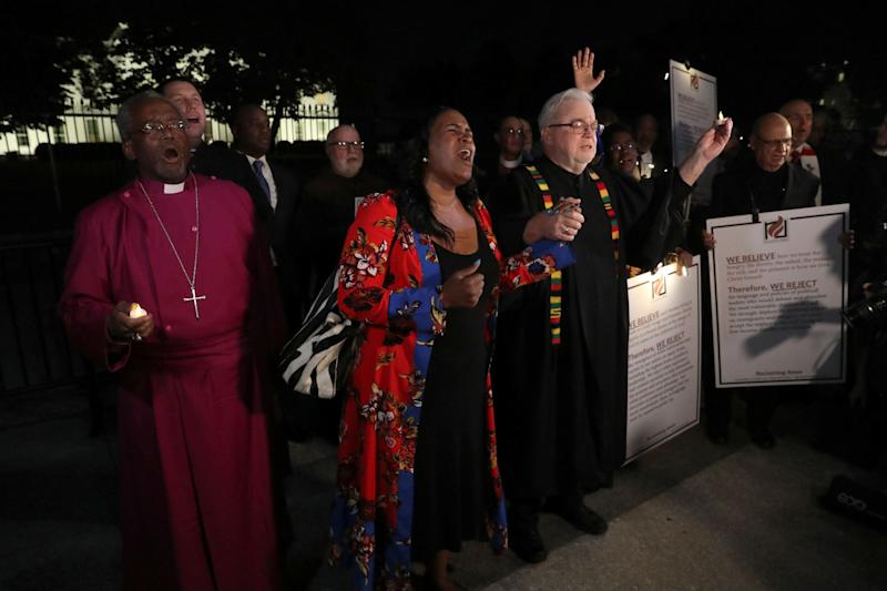 Episcopal Church Presiding Bishop Michael Curry (L) and Sojourners President and Founder Rev. Jim Wallis (R) lead fellow clergy in a vigil.