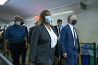 New York Attorney General Letitia James (L) and Manhattan District Attorney Cyrus Vance Jr. leave after attending the hearing for the criminal case against the Trump Organization