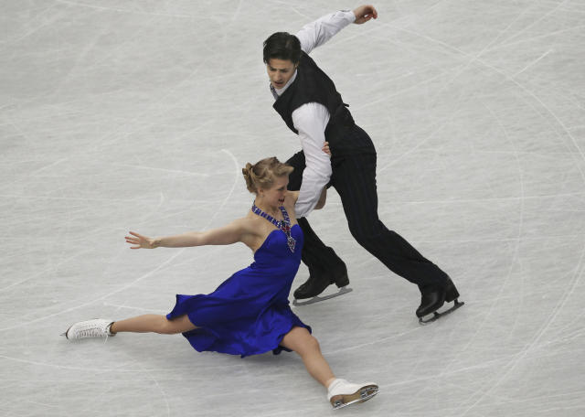 Kaitlyn Weaver and Andrew Poje of Canada perform during the ice dance short dance event of the World Figure Skating Championships in Saitama, near Tokyo, Friday, March 28, 2014. (AP Photo/Koji Sasahara)